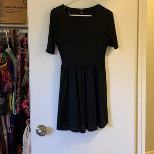 Short black ribbed dress